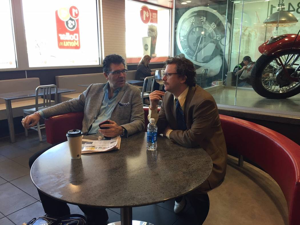 """Review-Journal columnist John Katsilometes and """"Opium"""" character/producer Harry M. Howie hold a summit at McDonald's on West Tropicana Avenue on Friday, March 2, 2018. (Thomas Judd)"""