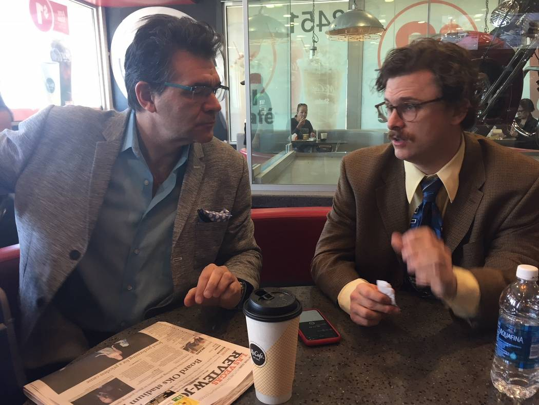 """Review-Journal columnist John Katsilometes and """"Opium"""" character/producer Harry M. Howie are shown at McDonald's on West Tropicana Avenue on Friday, March 2, 2018.  (John Katsilometes/Las Vegas Re ..."""