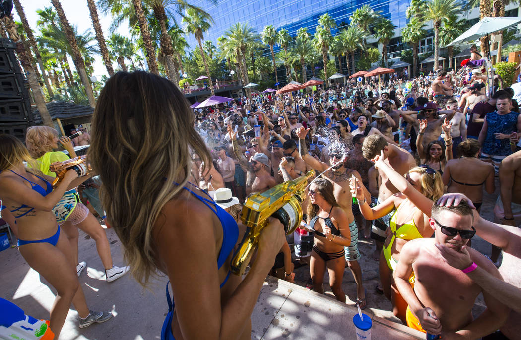 Champagne is shot out into the crowd as Lexy Panterra performs at Rehab dayclub at Hard Rock Hotel in Las Vegas on Saturday, June 24, 2017. (Chase Stevens/Las Vegas Review-Journal) @csstevensphoto