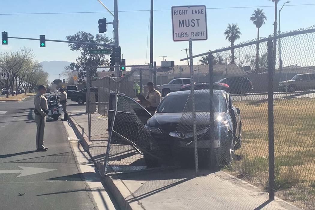 A car crashed into a gate at Fyfe Elementary School after a two-vehicle collision near Valley View Bouleveard and West Bonanza Road, Friday, March 8, 2018. (Bizuayehu Tesfaye/Las Vegas Review-Jour ...