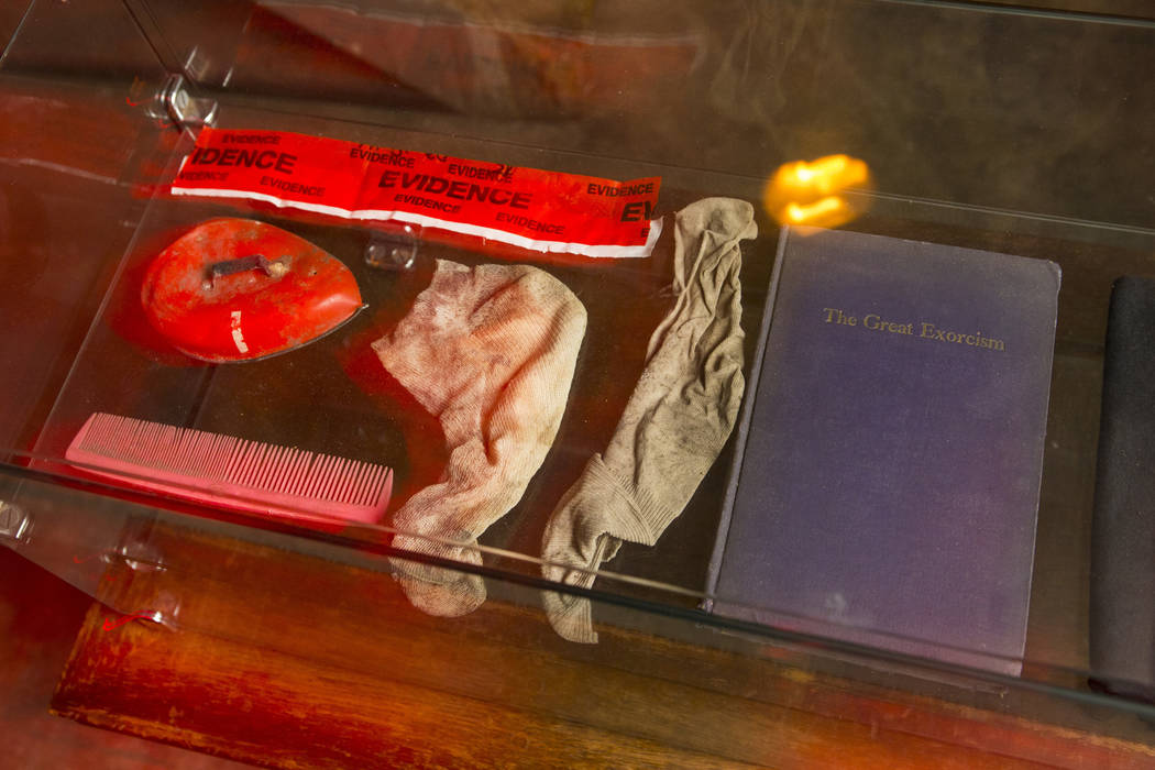 "Items collected as police evidence from the home featured in the upcoming documentary ""Demon House,"" by paranormal investigator Zak Bagans, at the Haunted Museum in downtown Las Vegas on ..."