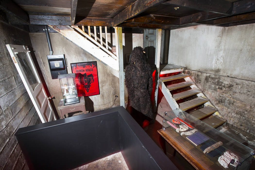 """Various items, a movie prop figurine, and a staircase from the home featured in the upcoming documentary """"Demon House,"""" by paranormal investigator Zak Bagans, at the Haunted Museum in do ..."""