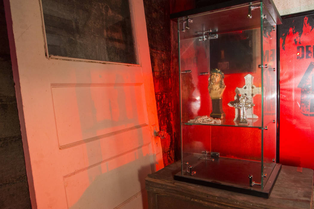 """Items found from the home featured in the upcoming documentary """"Demon House,"""" by paranormal investigator Zak Bagans, at the Haunted Museum in downtown Las Vegas on Tuesday, March 13, 201 ..."""