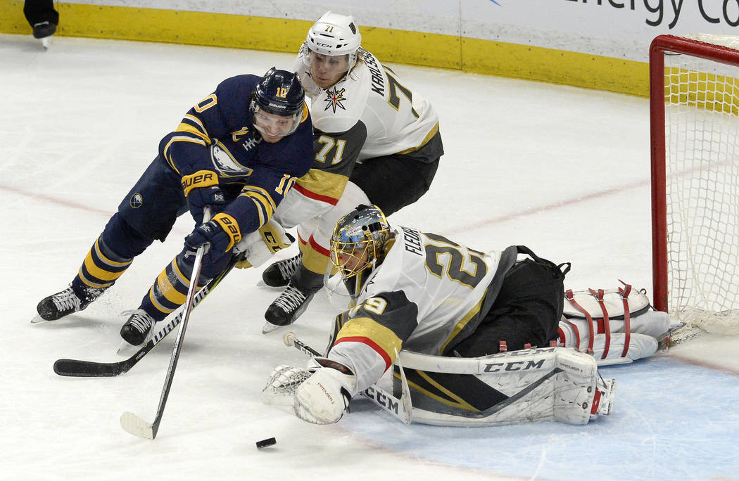 Buffalo Sabres center Jacob Josefson (10) tries to fight off Vegas Golden Knights center William Karlsson (71) as Golden Knights goalie Marc-Andre Fleury (29) makes a save during the third period  ...