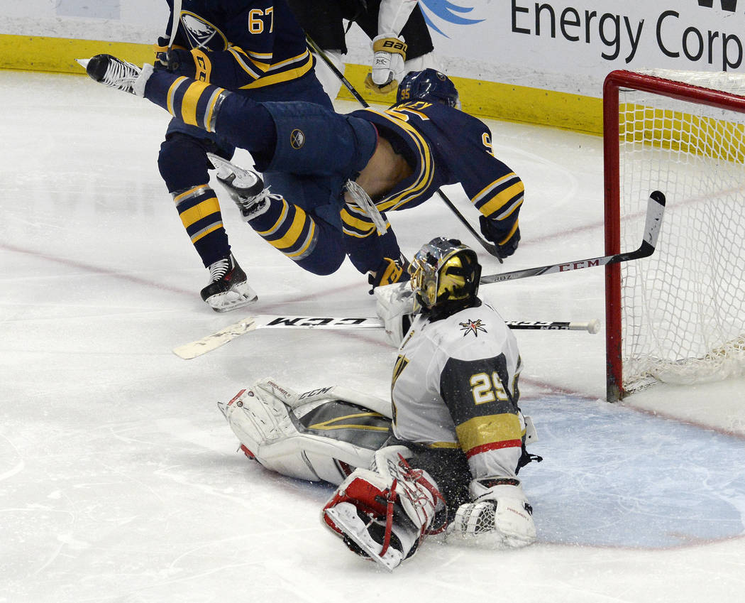 Buffalo Sabres right wing Justin Bailey (95) flips over Vegas Golden Knights goalie Marc-Andre Fleury (29) after scoring a goal during the third period of an NHL hockey game, Saturday, March 10, 2 ...