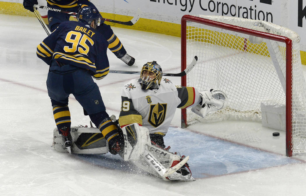 Buffalo Sabres right wing Justin Bailey (95) puts the puck by Vegas Golden Knights goalie Marc-Andre Fleury (29) for a goal during the third period of an NHL hockey game, Saturday, March 10, 2018  ...