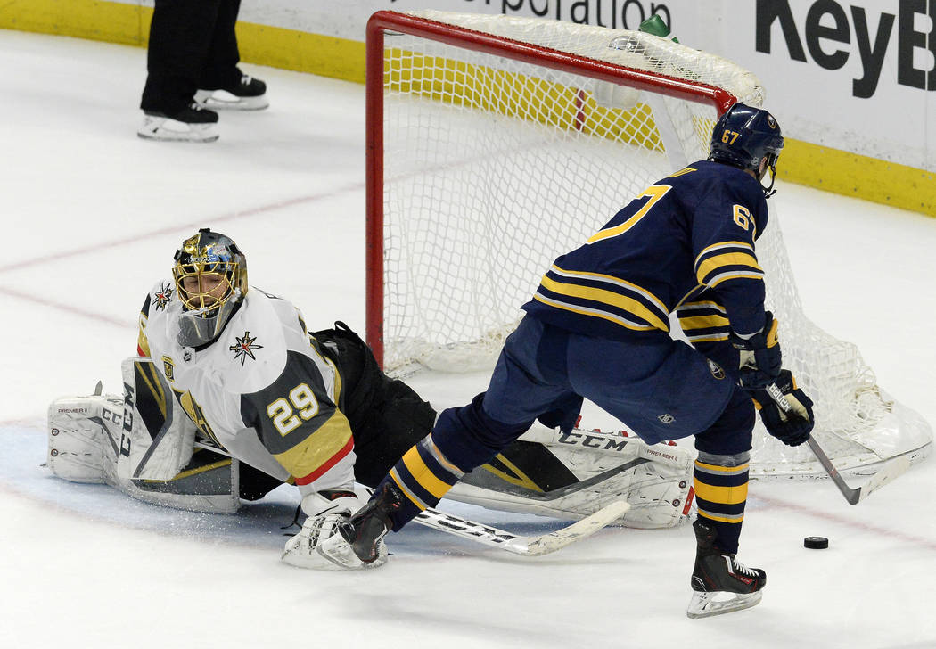 Buffalo Sabres left wing Benoit Pouliot (67) misses his shot against Vegas Golden Knights goalie Marc-Andre Fleury (29) during the shootout of an NHL hockey game, Saturday, March 10, 2018 in Buffa ...