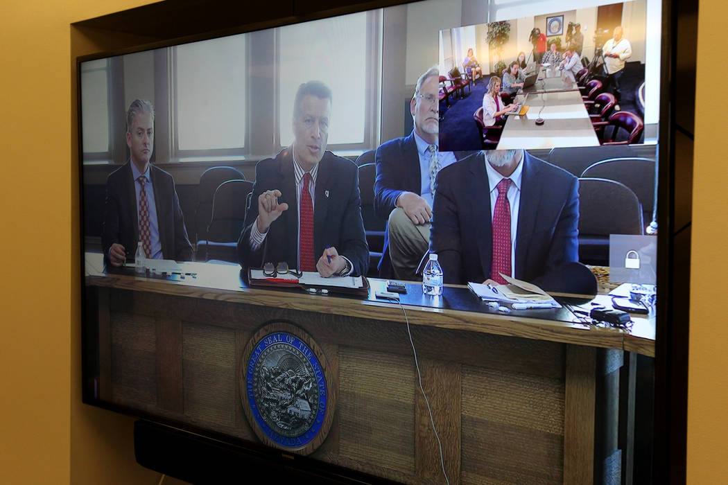 Gov. Brian Sandoval hosts a roundtable with Nevada school superintendents in Carson City and teleconferenced at the Sawyer Building in Las Vegas Monday, March 12, 2018, to discuss school safety. ( ...