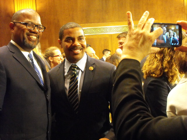 A friend takes a photo of Richard Boulware, left,  with his friend, Rep. Steven Horsford, D-Nev., after a confirmation hearing Wednesday before the Senate Judiciary Committee. (Steve Tetreault/Ste ...