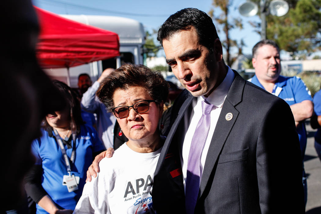 Gloria Caoile, president of the Asian Pacific American Labor Alliance, 70, left, hugs Rep. Ruben J. Kihuen, right, during a recognition ceremony for UMC Hospital workers and Sunrise Hospital worke ...