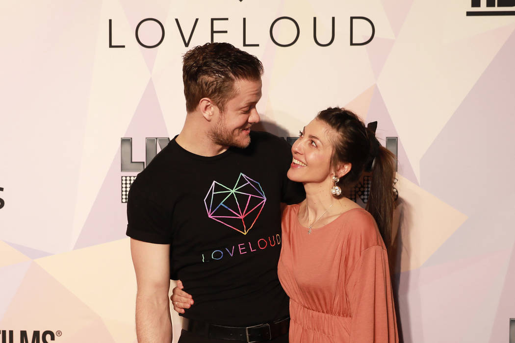 """Dan Reynolds, executive producer of """"Believer"""" and Imagine Dragons frontman, and his wife Aja Volkman pose before a VIP screening of his film at KA Theatre at MGM Grand in Las Vegas on T ..."""