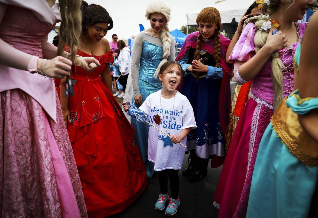 Bella Palicia, 6, reacts after seeing participants dressed as princesses during the Walk for Wishes event at the Town Square in Las Vegas on Saturday, March 10, 2018. The nationwide Make-A-Wish fu ...