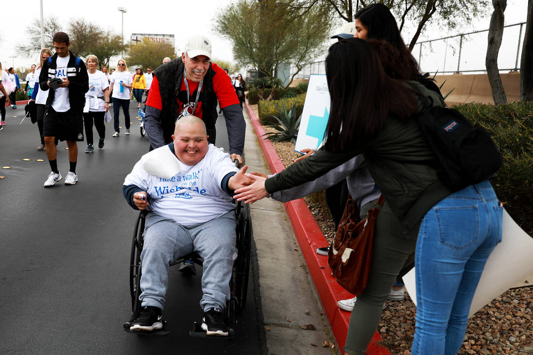 Raul Medrano and his 17-year-old nephew, Nazy Rodriguez, participate in the Walk for Wishes event at the Town Square in Las Vegas on Saturday, March 10, 2018. The nationwide Make-A-Wish fundraiser ...