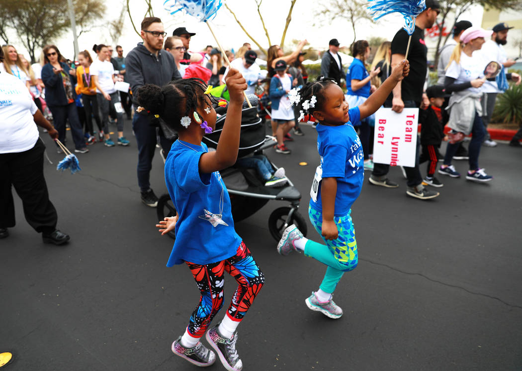 Kaya Moore-Banks, 7, left, and Zariyah Walls, 5, participate in the Walk for Wishes event at the Town Square in Las Vegas on Saturday, March 10, 2018. The nationwide Make-A-Wish fundraiser celebra ...