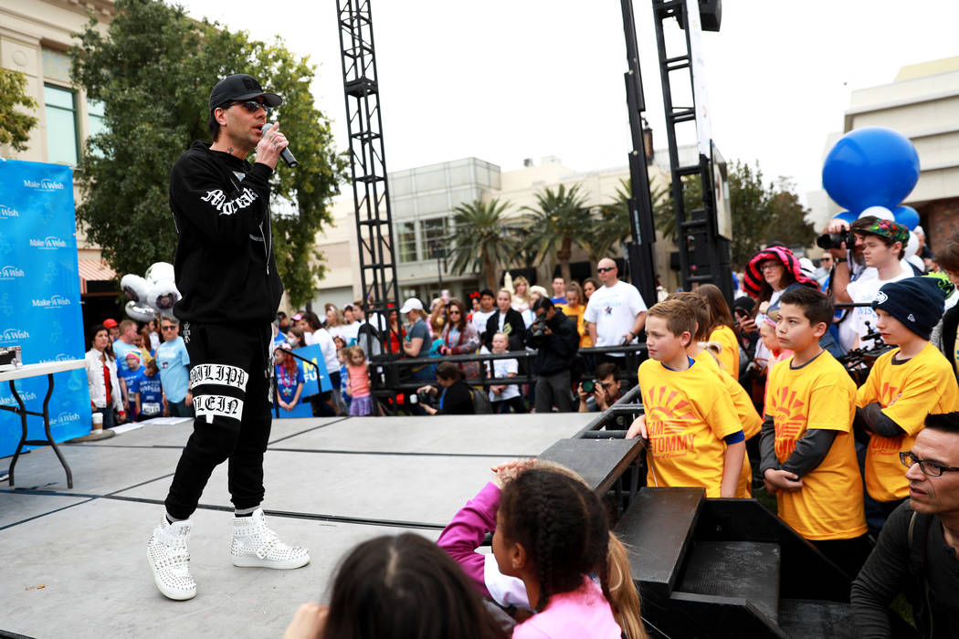 Magician Criss Angel, who donated $100,000 to Make-A-Wish, talks to the crowd before participating in the Walk for Wishes event at the Town Square in Las Vegas on Saturday, March 10, 2018. The nat ...