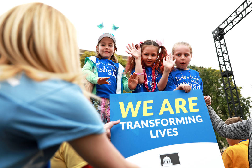 Volunteers, supporters, and wish families attend the Walk for Wishes event at the Town Square in Las Vegas on Saturday, March 10, 2018. The nationwide Make-A-Wish fundraiser celebrated thousands o ...