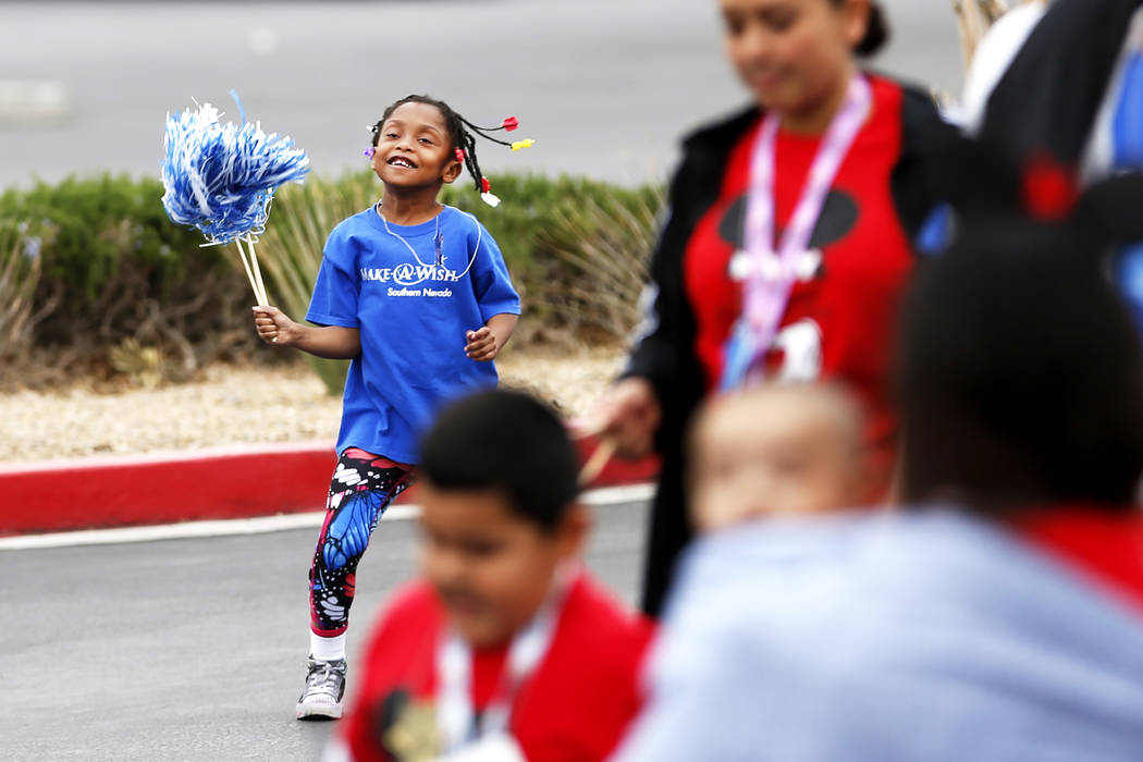 Kaya Moore-Banks, 7, participates in the Walk for Wishes event at the Town Square in Las Vegas on Saturday, March 10, 2018. The nationwide Make-A-Wish fundraiser celebrated thousands of wishes tha ...