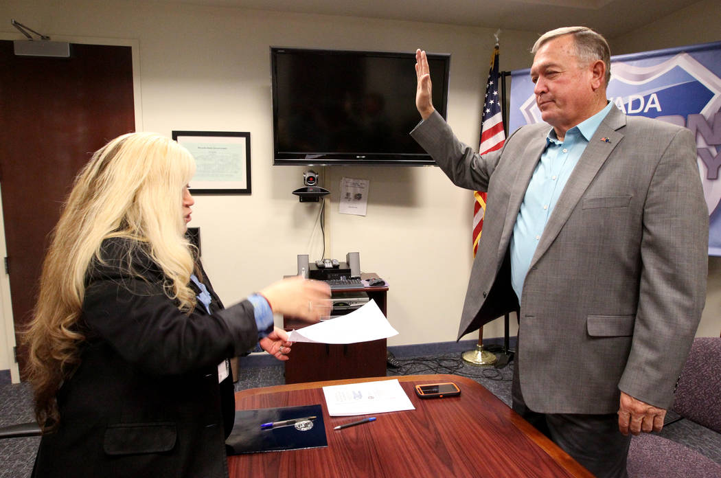 Former Nevada Rep. Cresent Hardy, right, takes the oath while filing to run for his old Congressional District 4 seat with Irene Jimenez-Muir at the Secretary of State Las Vegas office Monday, Mar ...