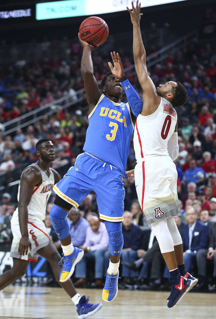 UCLA Bruins guard Aaron Holiday (3) goes to the basket against Arizona Wildcats guard Parker Jackson-Cartwright (0) during the first half of a semifinal basketball game in the Pac-12 basketball to ...