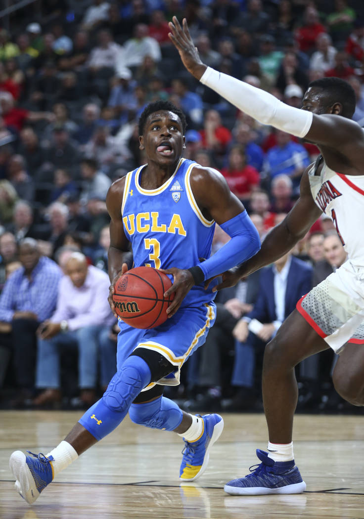 UCLA Bruins guard Aaron Holiday (3) drives past Arizona Wildcats guard Rawle Alkins (1) during the first half of a semifinal basketball game in the Pac-12 basketball tournament at T-Mobile Arena i ...