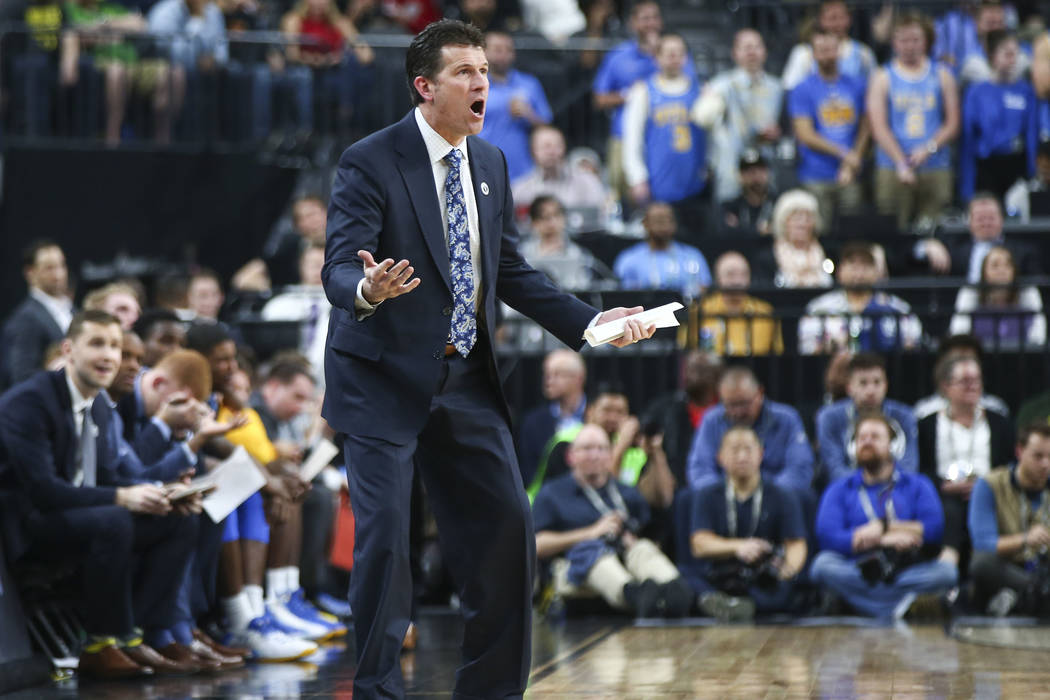 UCLA Bruins head coach Steve Alford shouts to his team as they play the Arizona Wildcats during the second half of a semifinal basketball game in the Pac-12 basketball tournament at T-Mobile Arena ...