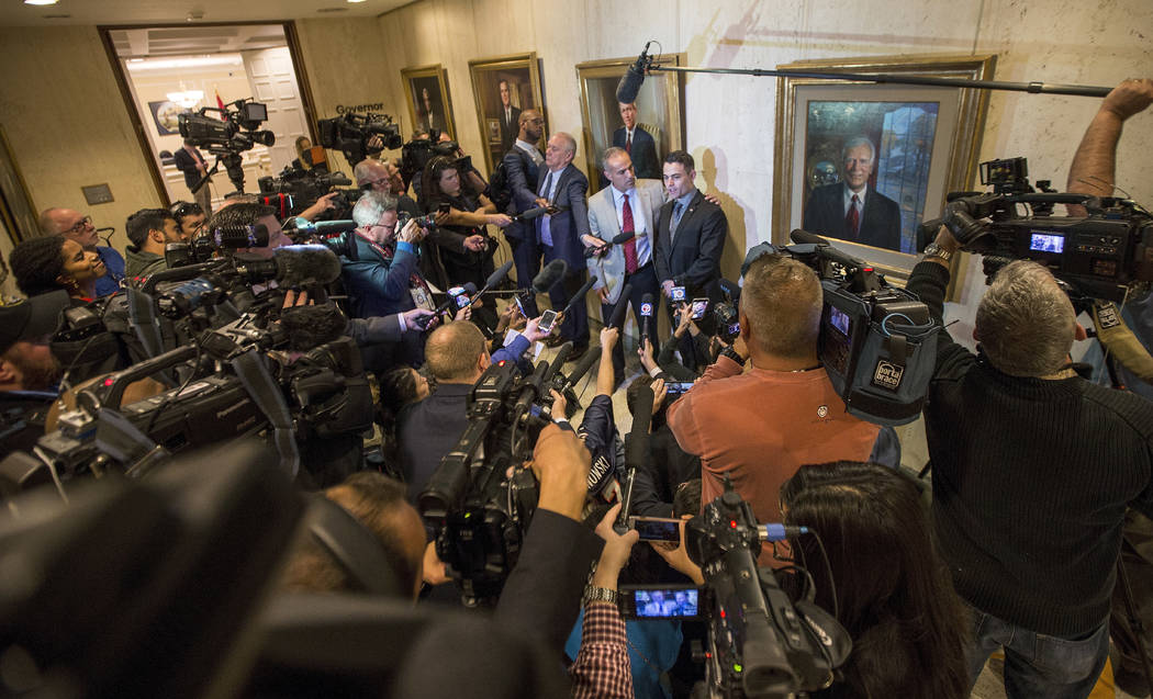 Parent Andrew Pollack, center left, and his son Hunter Pollack speak to the media outside the governor's office after the governor signed the Marjory Stoneman Douglas Public Safety Act at the Flor ...