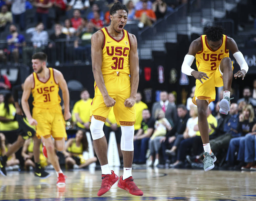 USC Trojans guard Elijah Stewart (30) celebrates after he scored against the Oregon Ducks during the first half of a semifinal basketball game in the Pac-12 basketball tournament at T-Mobile Arena ...