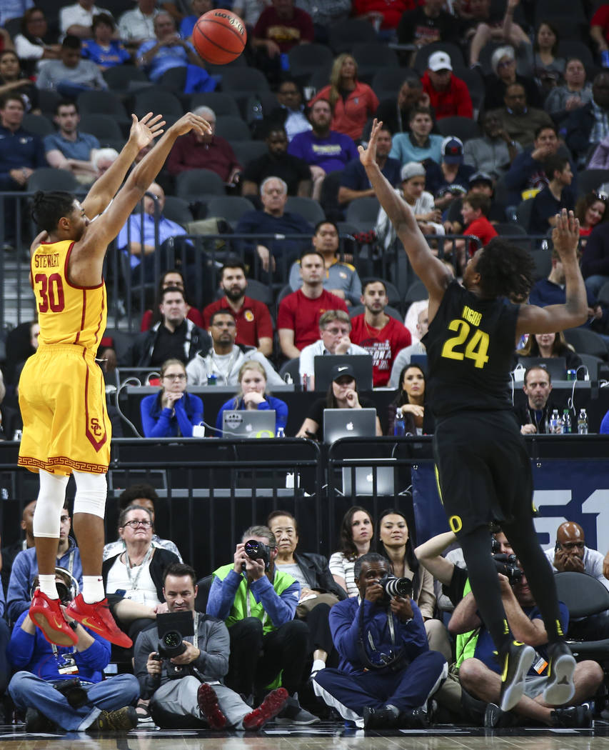 USC Trojans guard Elijah Stewart (30) shoots over Oregon Ducks forward Abu Kigab (24) during the first half of a semifinal basketball game in the Pac-12 basketball tournament at T-Mobile Arena in  ...