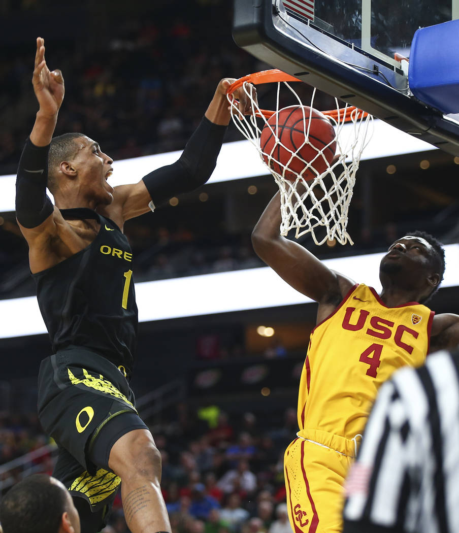 Oregon Ducks forward Kenny Wooten (1) dunks against USC Trojans forward Chimezie Metu (4) during the first half of a semifinal basketball game in the Pac-12 basketball tournament at T-Mobile Arena ...
