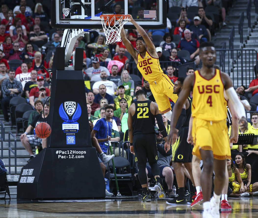 USC Trojans guard Elijah Stewart (30) dunks against the Oregon Ducks during the first half of a semifinal basketball game in the Pac-12 basketball tournament at T-Mobile Arena in Las Vegas on Frid ...