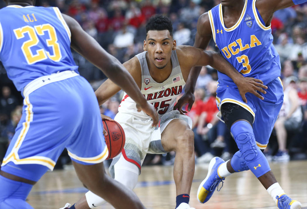 Arizona Wildcats guard Allonzo Trier (35) drives past UCLA Bruins guard Aaron Holiday (3) during the second half of a semifinal basketball game in the Pac-12 basketball tournament at T-Mobile Aren ...