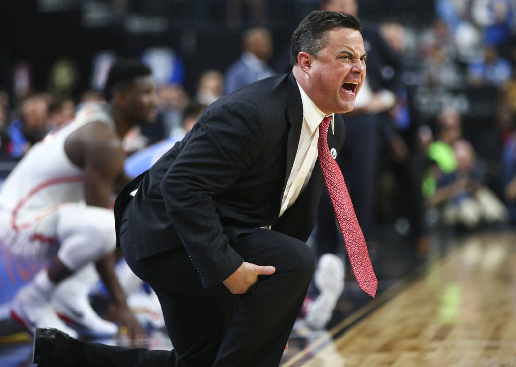 Arizona Wildcats head coach Sean Miller shouts to his team as they play the UCLA Bruins during the second half of a semifinal basketball game in the Pac-12 basketball tournament at T-Mobile Arena  ...