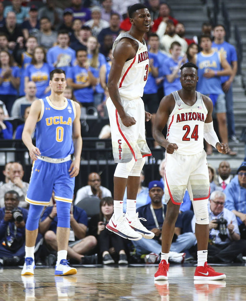 Arizona Wildcats guard Dylan Smith (3) reacts to a foul called as the team plays the UCLA Bruins tduring the second half of a semifinal basketball game in the Pac-12 basketball tournament at T-Mob ...