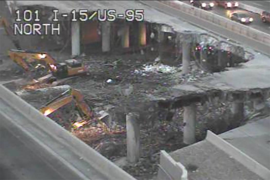 Crews tear down a bridge at the Spaghetti Bowl in Las Vegas on Saturday. (NDOT traffic cam)
