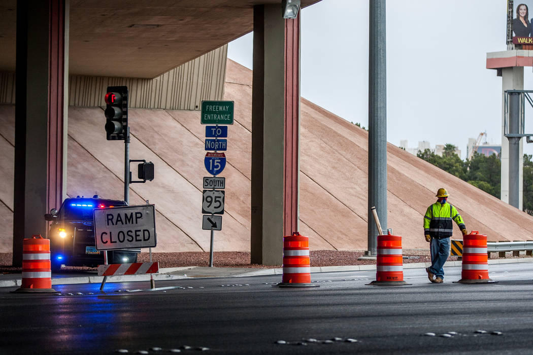 A construction worker and Nevada Highway Patrol trooper watch over the closed on-ramp to U.S. Highway 95 on Rancho Drive in Las Vegas on Saturday, March 10, 2018.  Patrick Connolly Las Vegas Revie ...