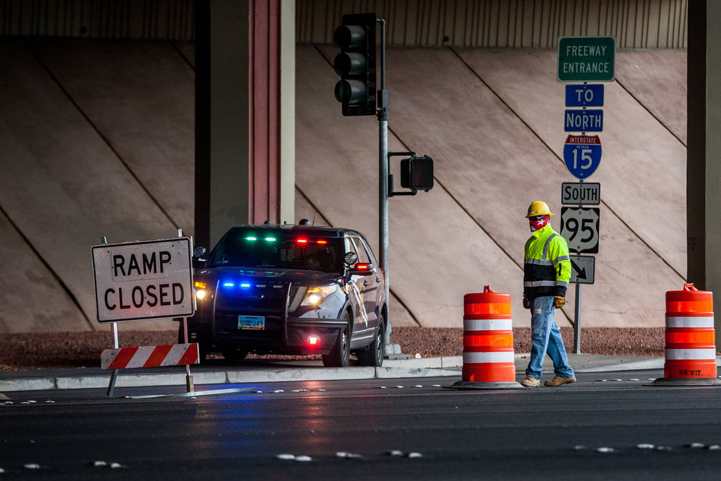 A construction worker and Nevada Highway Patrol trooper watch over the closed on-ramp to U.S. Highway 95 on Rancho Drive in Las Vegas on Saturday, March 10, 2018. Patrick Connolly Las Vegas Review ...