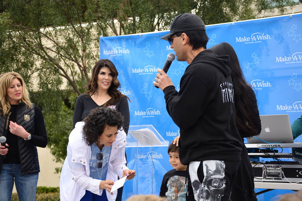 Criss Angel is shown with Kim Wagner of Channel 8, Mercedes Mix of 97.1 The Point-FM, and Make-A-Wish Southern Nevada President and CEO Caroline Ciocca. Angel donated $100,000 to the foundation at ...