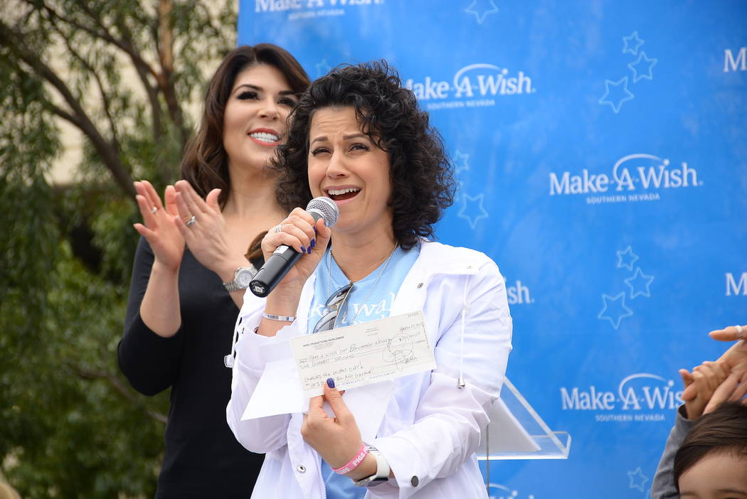 Make-A-Wish Southern Nevada President and CEO Caroline Ciocca reacts to a $100,000 check from Criss Angel at the Walk for Wishes at Town Square on Saturday, March 10, 2018. (Make-A-Wish Southern N ...