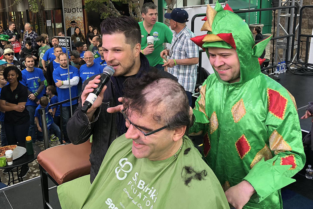 Piff the Magic Dragon and Mark Shunock are shown with Review-Journal columnist John Katsilometes at the St. Baldrick's shave-a-thon at New York-New York on Saturday, March 10, 2018. (St. Baldrick' ...