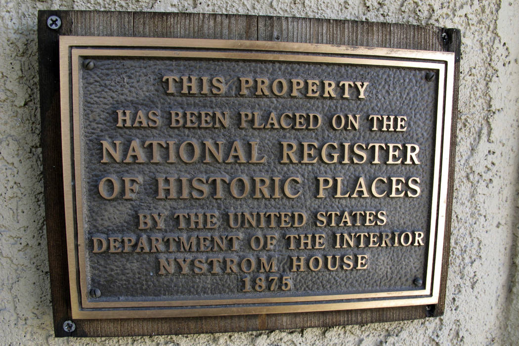 A historical plaque is displayed on the outside of the Nystrsom Guest House in downtown Reno. (AP Photo/Scott Sonner)