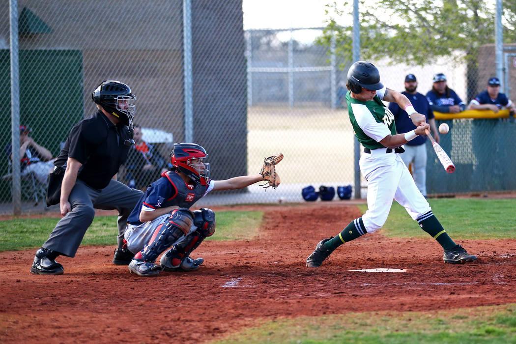 Rancho Rams' Joseph Walls (14) bats against the Liberty Patriots during a baseball game at Rancho High School on Monday, March 12, 2018, in Las Vegas. The Rams won 11-1. Andrea Cornejo Las Vegas R ...
