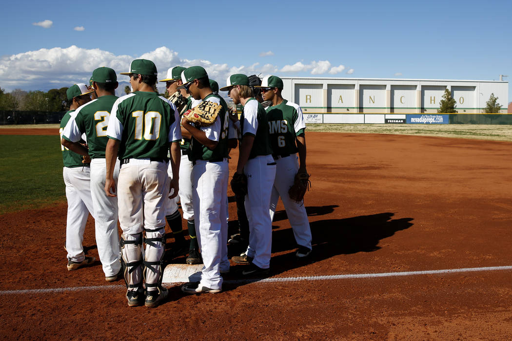 Rancho Rams huddle up before a game against the Liberty Patriots at Rancho High School on Monday, March 12, 2018, in Las Vegas. The Rams won 11-1. Andrea Cornejo Las Vegas Review-Journal @DreaCornejo