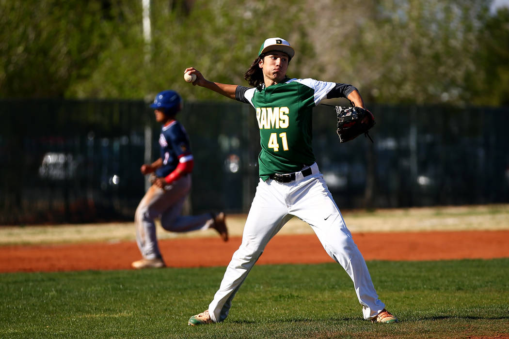 Rancho Rams' Layton Walls (41) throws towards first base during a game against the Liberty Patriots at Rancho High School on Monday, March 12, 2018, in Las Vegas. The Rams won 11-1. Andrea Cornejo ...