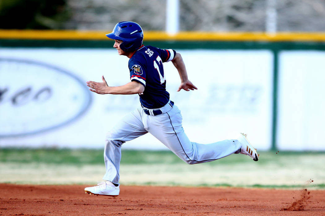 Liberty Patriots' Ethan Safier (17) runs towards third base during a game against the Rancho Rams at Rancho High School on Monday, March 12, 2018, in Las Vegas. The Rams won 11-1. Andrea Cornejo L ...