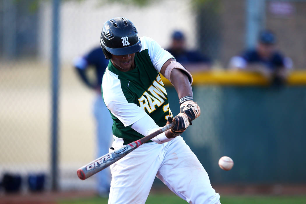 Rancho Rams' Edarian Williams (32) bats against the Liberty Patriots during a game at Rancho High School on Monday, March 12, 2018, in Las Vegas. The Rams won 11-1. Andrea Cornejo Las Vegas Review ...