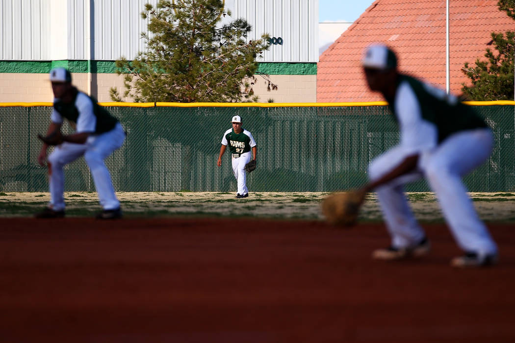 Rancho Rams' Anthony Guzman (27) waits for a pitch during a game against the Liberty Patriots at Rancho High School on Monday, March 12, 2018, in Las Vegas. The Rams won 11-1. Andrea Cornejo Las V ...