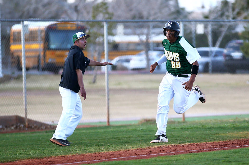 Rancho Rams' Jimmy Gamboa (99) runs towards home plate during a game against the Liberty Patriots at Rancho High School on Monday, March 12, 2018, in Las Vegas. The Rams won 11-1. Andrea Cornejo L ...