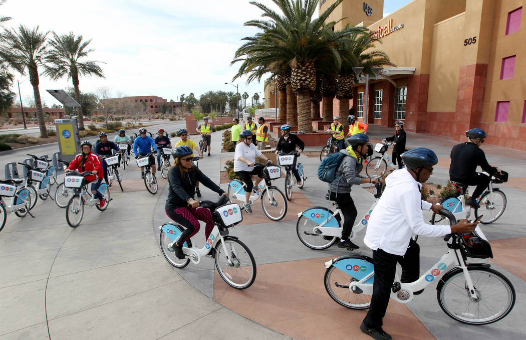 Cyclists set out for a ride at a Regional Transportation Commission Bike Share station near the Clark County Government Center Monday, March 12, 2018, for a bike ride through historic West Las Veg ...