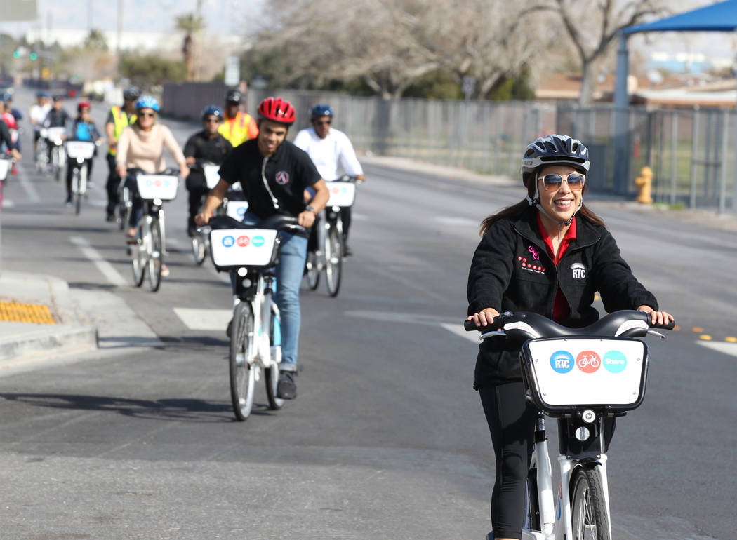Angela Castro with the Regional Transportation Commission, right, on Tonopah Drive near Washington Avenue Monday, March 12, 2018, during a bike ride through historic West Las Vegas. The ride, whic ...