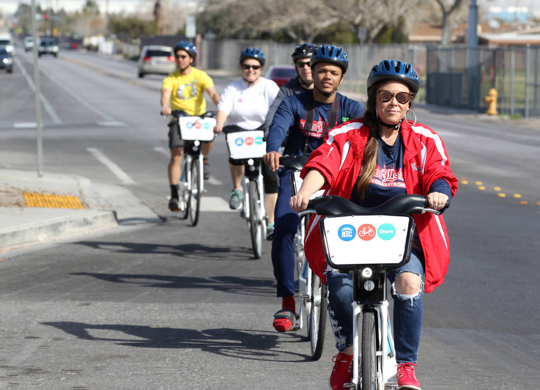Krissy Bashaw, right, and her son Octavian Bell, second from right, on Tonopah Drive near Washington Avenue Monday, March 12, 2018, during a bike ride through historic West Las Vegas. The ride, wh ...